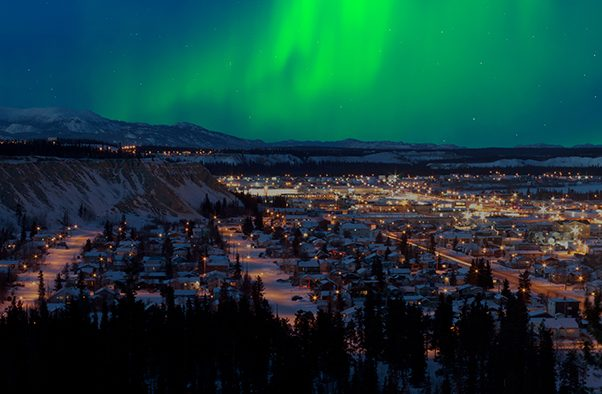 Image of the Yukon at night with Northern Lights in the distance for Building Familiarity with Federal Foresight Approaches and Tools in the Yukon blog post