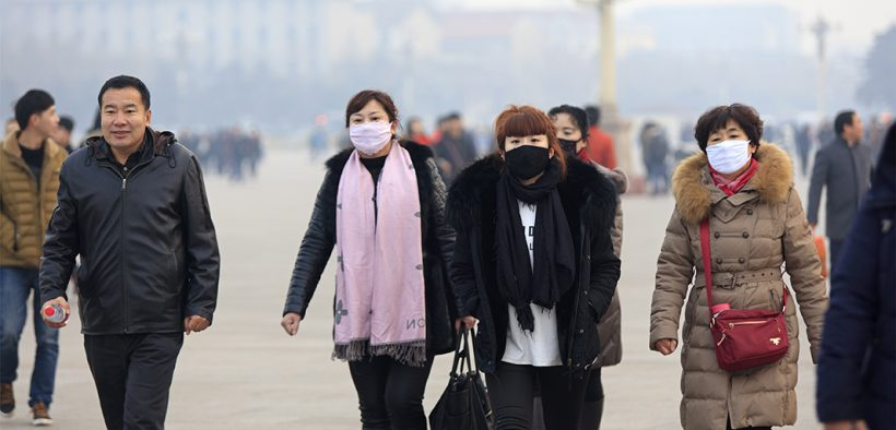 Image of people walking and wearing face masks for Cross Border Air Pollution in Asia blog post