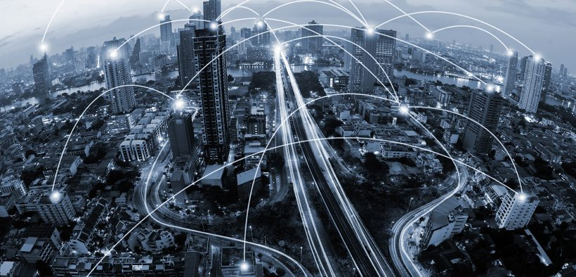 Image of a city with line connecting building depicting wireless communication for Canada 2030 Scan of Emerging Issues Infrastructure blog post