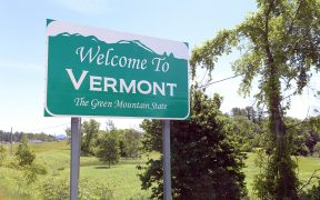 Image of the Welcome to Vermont road sign for Vermont will pay remote Teleworkers $10,000 to move there blog post