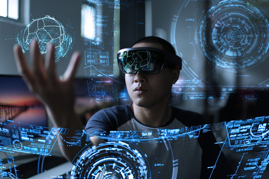Image of man wearing mixed reality headset and interacting with virtual objects