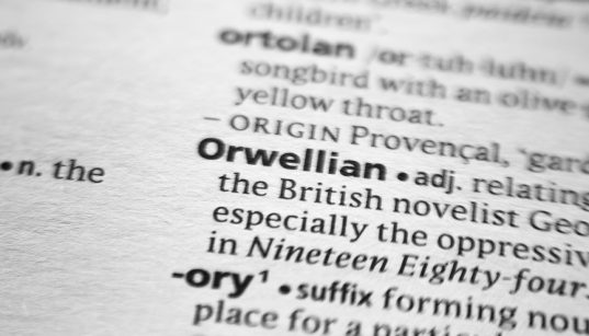 """A dictionary entry for the word """"Orwellian"""" with a blur around the word """"Orwellian"""""""