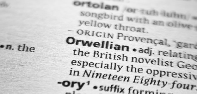 "A dictionary entry for the word ""Orwellian"" with a blur around the word ""Orwellian"""