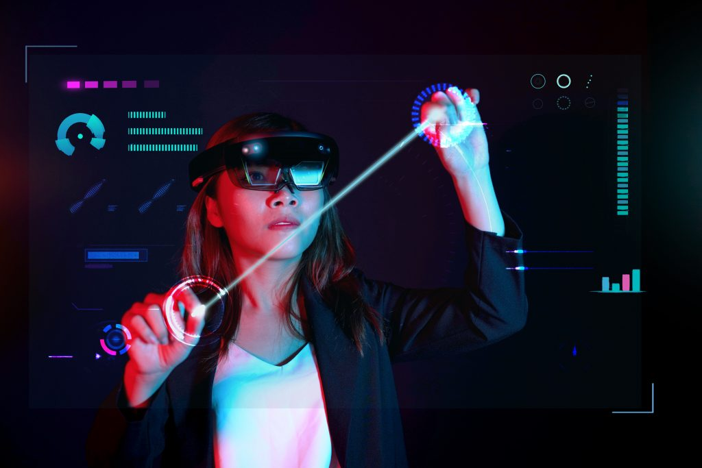 Woman using smart glasses to interact with an augmented reality interface